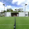 3-grass-tennis-court-modern-caribbean-home