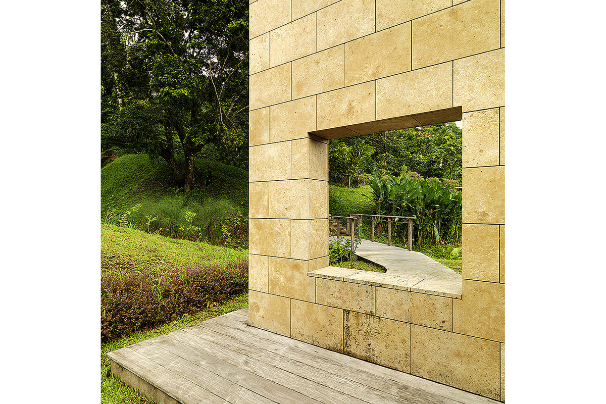 7-domaine-d-emeraude-limestone-wall-window-garden-path
