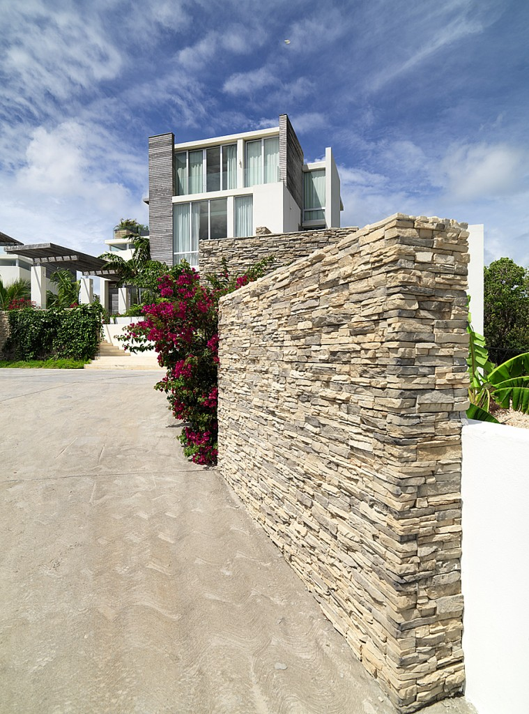 Stone flank walls leading to the entrance forecourt