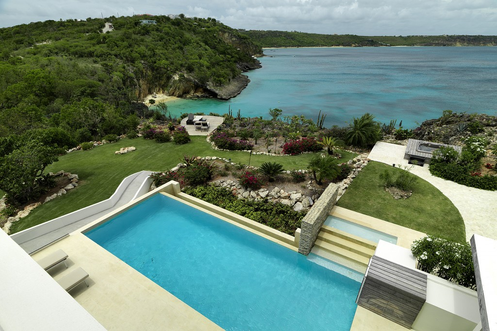 View from a bedroom overlooking the swimming pool, jacuzzi, gardens and the Caribbean