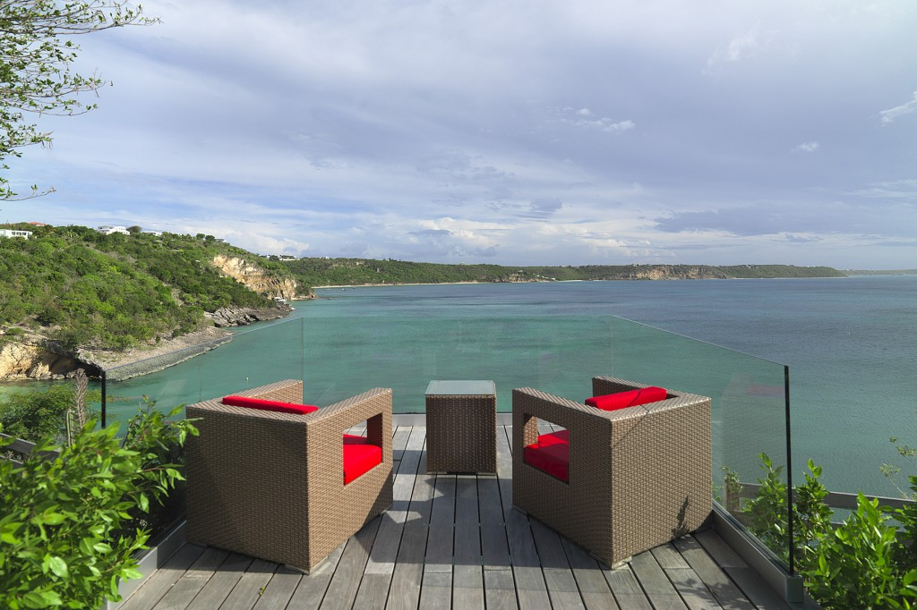 The ultimate view from glass enclosed deck cantilevered  off the edge of the bluff overlooking the Caribbean