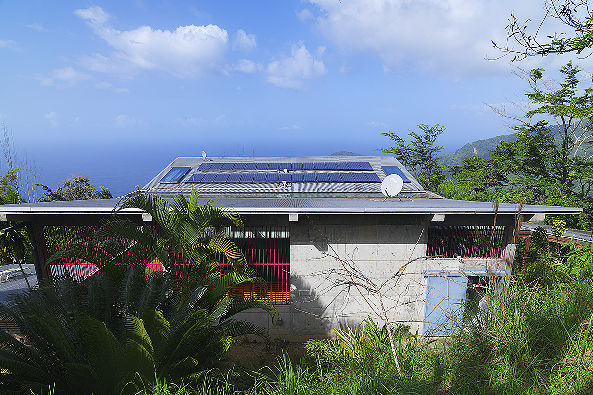 photovoltaic-panels-corrigated-galvanised-roof-artist-hillside-house