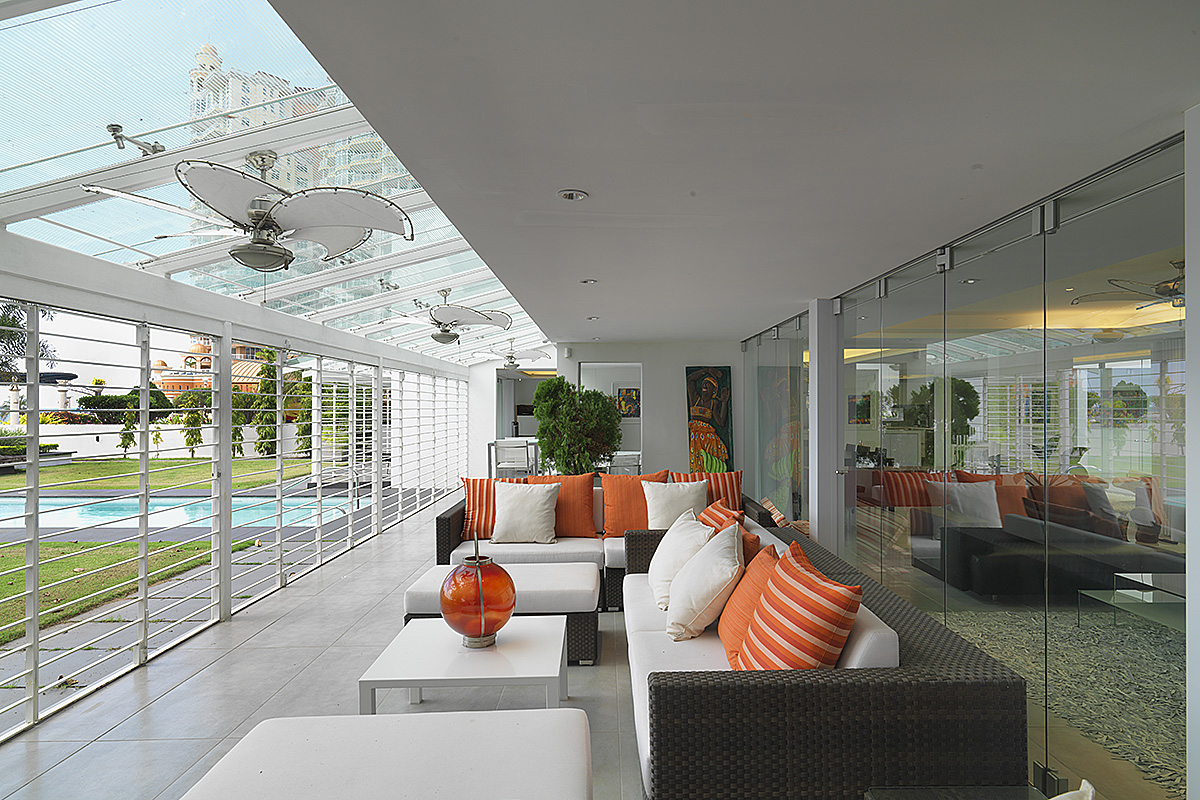 covered porch with fritted glass skylight with roller blinds and openable security grilles