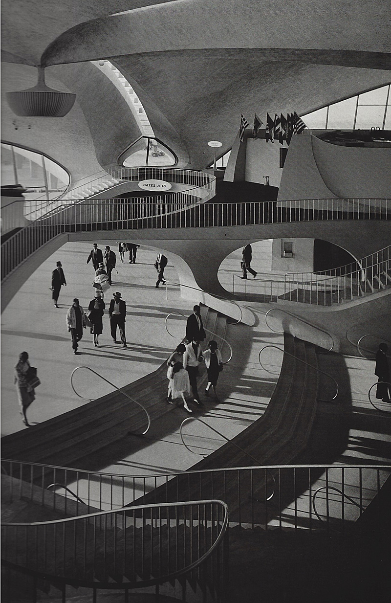 Ezra Stoller image of TWA terminal at JFK by Eero Saarinen The TWA terminal would look out of place without any people in it. Stoller must have taken dozens of images to get people dispersed in this well-balanced composition.