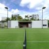 3-grass-tennis-court-modern-caribbean-home